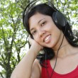 Woman listening to music — Foto de Stock