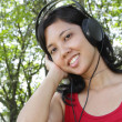Woman listening to music — Stock Photo #4128663