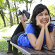 Woman on a bench — Stockfoto