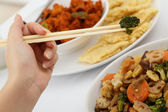 Chopstick and broccoli — Stock Photo