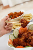Chopsticks and meat — Stock Photo