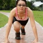Runner in starting stance — Stock Photo #5018872