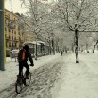 City biker in the snow — Stock Photo