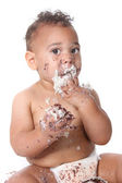 Sweet baby boy eating birthday cake — Stock Photo