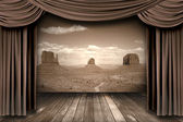 Hanging stage theater curtains with a desert background — Stock Photo