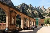 Arch and sculptures of Montserrat monastery — Stock Photo