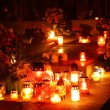 Stock Photo: Candles burning at cemetery