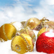 Christmas bauble on white snow background — Stock Photo
