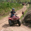 Dad with son riding quad — Stock Photo #3988286