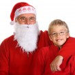 Grandfather as a Santa Claus with his grandson — Stock Photo
