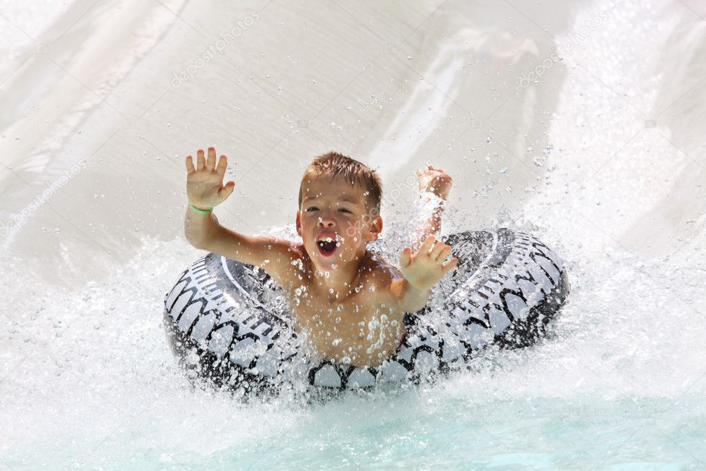 A boy having fun in water park   Stock Photo #4083707