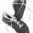 Old grungy Running Shoes isolated - Stock Photo