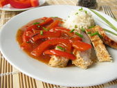 Pork cutlet with lecho and rice — Stock Photo