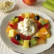 Fruits salad with almond curd cheese — Stock Photo