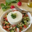Goat cream cheese on vegetable salad with radishes — Stock Photo