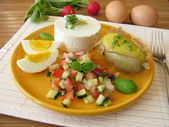 Goat cream cheeses with salad, potato and egg — Stock Photo