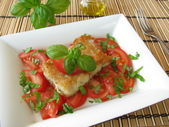 Fish with tomatoes and basil — Stock Photo