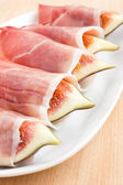Figs in Prosciutto Italian cured ham — Photo
