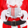 Santa holding present - Stock Photo