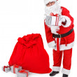Santa claus gives a present — Stock Photo