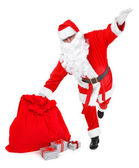 Funny pose of santa claus on white — Stock Photo