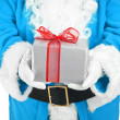 Blue santa holding present — Stock Photo