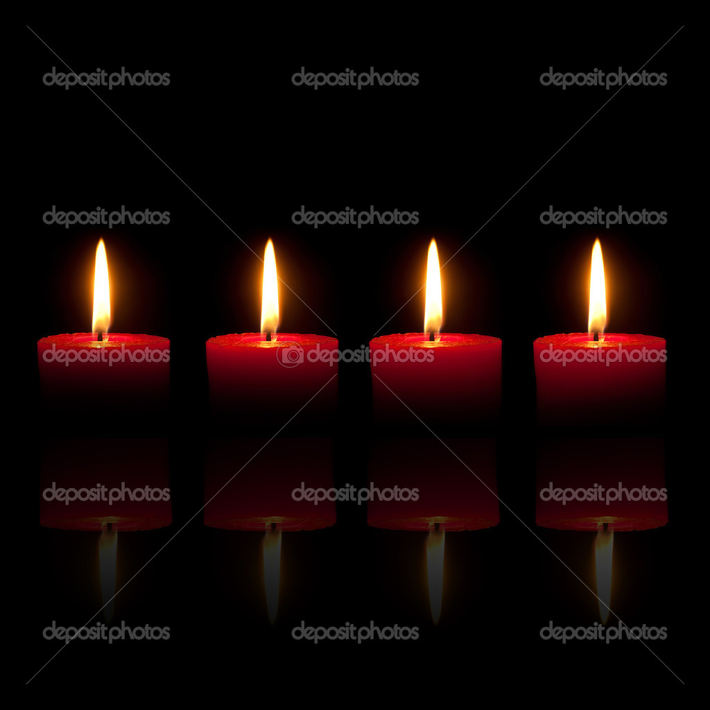 Four burning red candles in front of black background — Stock fotografie #3937938