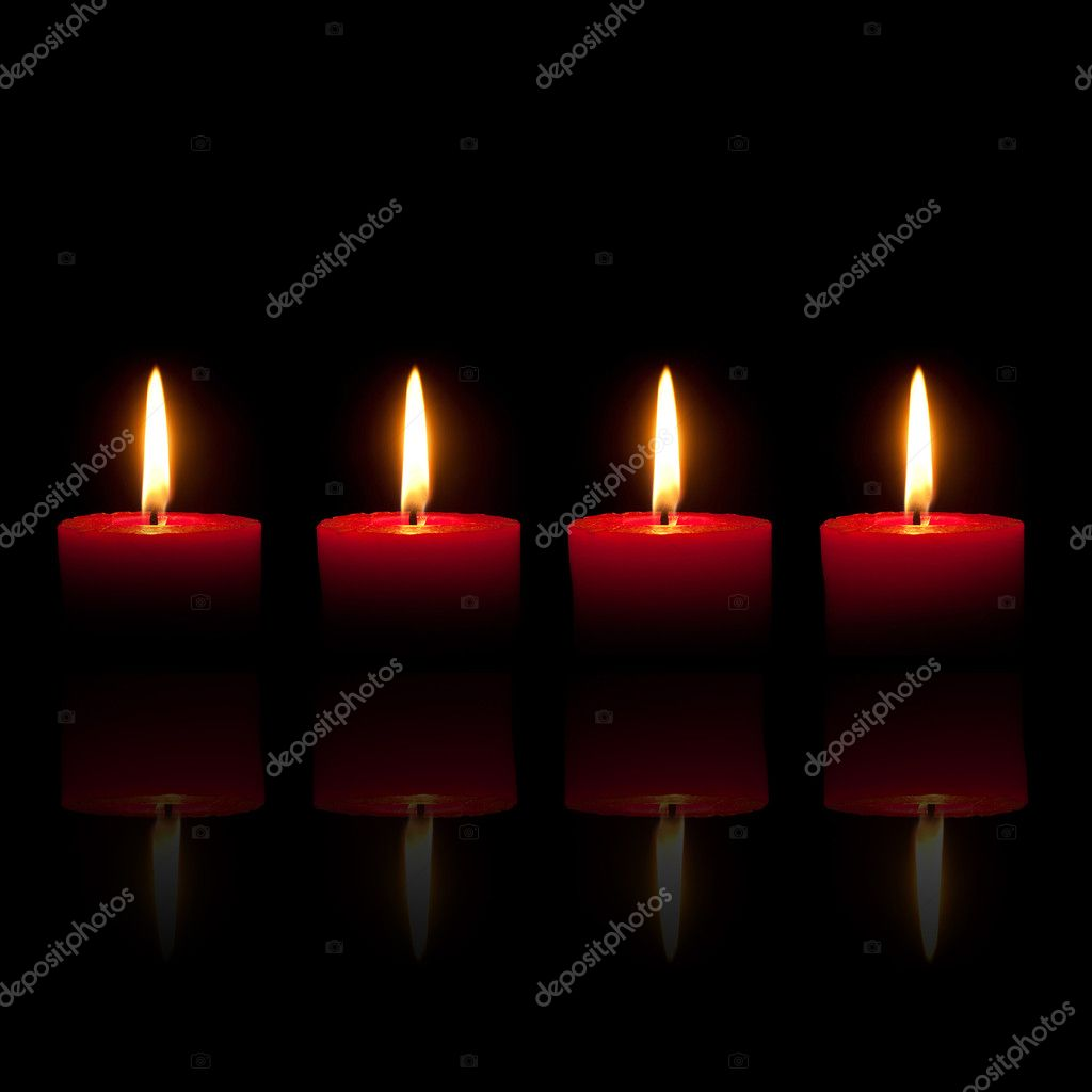 Four burning red candles in front of black background — Stok fotoğraf #3937938