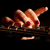 Young woman playing flute — Stock Photo