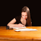 Pretty young woman writing a letter — Stock Photo