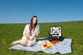 Beautiful young woman having a picnic — Stock Photo
