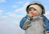 Thoughtful little boy against the sky — Stock Photo