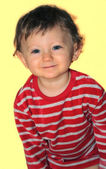 A smiling little boy in pajamas — Stock Photo