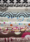 Large Stack of Multiple Patterned Fabrics — Stock Photo