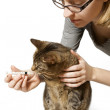Woman Giving Cat Medication — Stock Photo