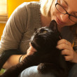 WomHugging Cat on Lap — Stockfoto #4460281