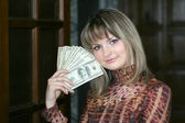 Money in the hands girl — Stock Photo