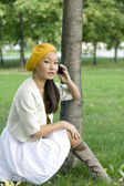 Girl talking by phone — Stock Photo