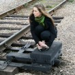 Girl sitting near railroad — Stock Photo