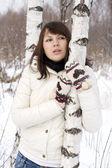 Cute girl walking in winter forest — Stock Photo