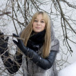 Stockfoto: Girl walking in winter forest