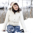 Cute girl walking in winter forest — Stock Photo