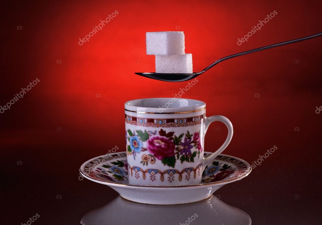 Cup of coffee and sugar on a dark red background  Stock Photo #4672707