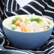 Blue bowl with cooked rice with mixed vegetable — Stock Photo #4974477