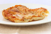 Lasagne on white plate — Stock Photo