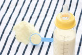 Feeder bottle and dried milk — Stock Photo