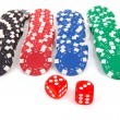 Colorful poker casino chips and red dices — Stock Photo #3947167