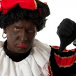 Zwarte Piet ( black pete) typical dutch character with thumbs do - Stock Photo