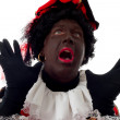 Surprised Zwarte Piet ( black pete) typical dutch character - Stock Photo