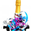 Neck of closed champagne bottle packed in golden paper - Stock Photo